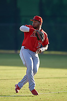 AZL Angels right fielder Raider Uceta (75) makes a throw to the infield during a game against the AZL Giants Orange at Giants Baseball Complex on June 17, 2019 in Scottsdale, Arizona. AZL Giants Orange defeated AZL Angels 8-4. (Zachary Lucy/Four Seam Images)
