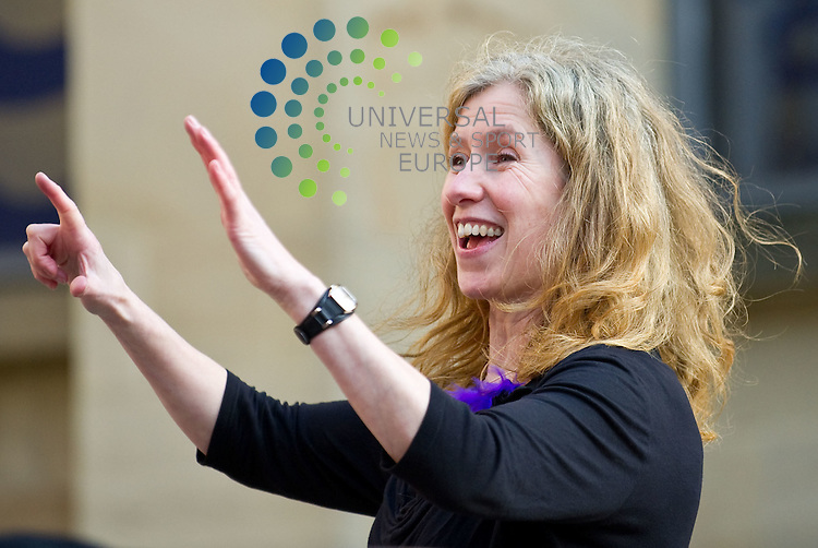 Nichola Scrutton, co director of Hum Drum, conducts the singers and drummers. To celebrate the 100th anniversary of International Women's Day 100 women sing and play drums during HUM DRUM to crowds in Buchanan Street Glasgow on 5 March 2011, Picture: Al Goold/Universal News and Sport (Europe) 2011.