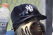 New York Yankees minor league player hat and glove sit on the dugout step during a game vs the Toronto Blue Jays at the Englebert Minor League Complex in Dunedin, Florida;  March 21, 2011.  Photo By Mike Janes/Four Seam Images