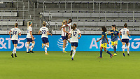 ORLANDO, FL - JANUARY 22: Lindsey Horan #9 celebrates her goal with Crystal Dunn #19 and teammates during a game between Colombia and USWNT at Exploria stadium on January 22, 2021 in Orlando, Florida.