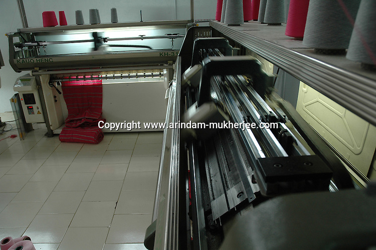 Kauo Henc a Taiwan made collar making unit at Popy's factory in Tirupur, Tamilnadu. After lifting of quota system in textile export on 1st january 2005. Tirupur has become the biggest foreign currency earning town of India.