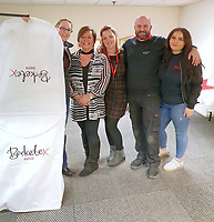 """COPY BY TOM BEDFORD<br /> Pictured L-R: Bride to be Megan Stamp with staff members Jo Williams, Michelle Curry, Adam Bowdidge and Lara Williams at the John Pye Auctions warehouse in Pyle, south Wales, UK.<br /> Re: A bride cried tears of joy after her missing wedding dress was found among a pile of 20,000 gowns in a warehouse.<br /> Meg Stamp, 27, paid £1,300 for the beautiful ivory lace dress but it  was seized by liquidators after a bridal company went bust.<br /> It was boxed up along with 20,000 others and due to be sold for a knock-down price at auction.<br /> But determined Meg banged on the auctioneer door saying: """"I want my dress back"""".<br /> Staff at John Pye auctioneers in Port Talbot spent three hours sifting through boxes until they finally found Meg's dream dress."""