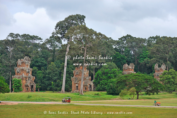 Ruins in forest and tourists at Angkor Wat, Cambodia