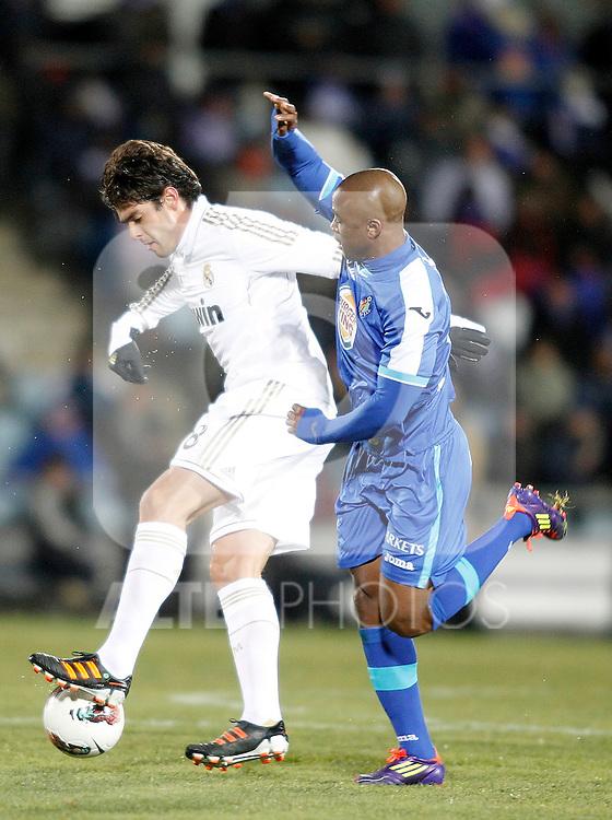 Real Madrid's Kaka against Getafe's Tsepo Masilela during La Liga match. February 04, 2012. (ALTERPHOTOS/Alvaro Hernandez)