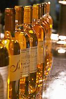 Bottles of sweet white bordeaux wine. Chateau de Cerons, Sauternes. Bordeaux, France
