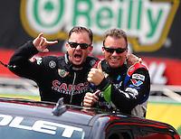 Jun 21, 2015; Bristol, TN, USA; NHRA top fuel driver Steve Torrence (left) with Clay Millican during the Thunder Valley Nationals at Bristol Dragway. Mandatory Credit: Mark J. Rebilas-
