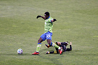 COLUMBUS, OH - DECEMBER 12: Yeimar Gomez Andrade #28 of the Seattle Sounders FC takes the ball away from Lucas Zelarayan #10 of the Columbus Crew during a game between Seattle Sounders FC and Columbus Crew at MAPFRE Stadium on December 12, 2020 in Columbus, Ohio.