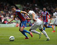 Pictured L-R: Joel Ward of Crystal Palace against Jefferson Montero of Swansea<br /> Re: Premier League match between Crystal Palace and Swansea City at Selhurst Park on Sunday 24 May 2015 in London, England, UK