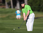 Green Bay Packers linebacker A.J. Hawk watches his shot during a practice round at the 22nd American Century Celebrity Golf Championship at Edgewood Tahoe Golf Course in Stateline, Nev., on Thursday, July 14, 2011. <br />