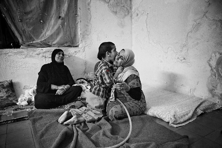 4.4..2015, Kirkuk,Iraq:  Mohammad 5 years old kissing his mother's eye.