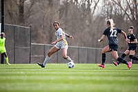 LOUISVILLE, KY - MARCH 13: Gabrielle Robinson #8 of West Virginia University looks to steal the ball from Katie McClure #22 of Racing Louisville FC during a game between West Virginia University and Racing Louisville FC at Thurman Hutchins Park on March 13, 2021 in Louisville, Kentucky.