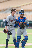 Scottsdale Scorpions starting pitcher Forrest Whitley (11), of the Houston Astros organization, and catcher Ali Sanchez (25), of the New York Mets organization, walk off the field between innings of an Arizona Fall League game against the Glendale Desert Dogs at Camelback Ranch on October 16, 2018 in Glendale, Arizona. Scottsdale defeated Glendale 6-1. (Zachary Lucy/Four Seam Images)