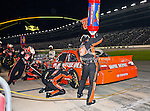 Joey Logano, driver of the (20) The Home Depot Toyota, makes a pit stop during the Samsung Mobile 500 Sprint Cup race at Texas Motor Speedway in Fort Worth,Texas.