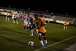 """March 14, 2009. Cary, NC.. The Carolina Railhawks went home in foul weather with a  1-0 victory over the New England Revolution of the MLS, in the inaugural """"Community Shield"""" match and their first professional outing under new coach, Martin Rennie. . #17, Joseph Kabwe."""