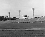 Bethel Park Senior High School:  View of the ongoing construction of the new High School Football Stadium.  The new Bethel Senior High School was dedicated on October 23, 1960, but the campus would not grow to its current size until seven years later. Phase II of the construction was completed in 1964 with the addition of another academic building and the industrial arts building. Phase III was completed in 1967 with the construction of the fourth academic building and a 6,300 seat football stadium and track, three tennis courts, seven basketball courts, and a baseball field.
