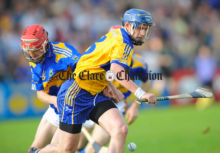 Clare's Conor Cooney is chased by Tipperary's Seamus Callinan during the Munster U-21 final at Cusack park. Photograph by John Kelly.
