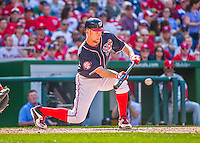 23 May 2015: Washington Nationals starting pitcher Stephen Strasburg lays down a sacrifice bunt the during a game against the Philadelphia Phillies at Nationals Park in Washington, DC. The Phillies defeated the Nationals 8-1 in the second game of their 3-game weekend series. Mandatory Credit: Ed Wolfstein Photo *** RAW (NEF) Image File Available ***