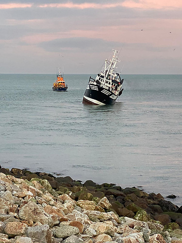 The tide was rising and the lifeboat eased the trawler off the rocks and into deeper water