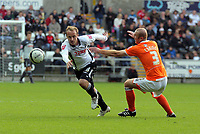 ATTENTION SPORTS PICTURE DESK<br /> Pictured: Tom Butler of Swansea (L) avoiding Stephen Crainey of Blackpool (R)<br /> Re: Coca Cola Championship, Swansea City Football Club v Blackpool at the Liberty Stadium, Swansea, south Wales. Saturday 24 October 2009