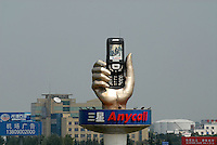 A large 3D Samsung Anycall mobile phone advert in Chengdu, China. Samsung is one of the sponsors of the 2008 Beijing Olympic Games. .