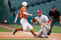 Houston Cougars first baseman Casey Grayson #18 catches a pickoff throw at first base during the NCAA baseball game against the Texas Longhorns on March 1, 2014 during the Houston College Classic at Minute Maid Park in Houston, Texas. The Longhorns defeated the Cougars 3-2. (Andrew Woolley/Four Seam Images)