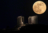 A May super moon, known also as a flower moon is seen rising over the ancient temple of Poseidon in Sounion, near Athens, Greece. Wednesday 26 May 2021