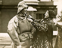 BNPS.co.uk (01202 558833)<br /> Pic: Photopress/RNLI<br /> <br /> Bravery medal winners - Frederick Barnes, Selsey coxswain with Mrs Polly Donkin of Cullercoats, 13 May 1931<br /> <br /> Splash in the Attic...<br /> <br /> A 'lost' cache of 13,000 photographs charting the history of the RNLI has been found in the attic of the charity's headquarters.<br /> <br /> Many of the black and white photos date back to the 1920s and '30s long before the terms 'health and safety' and 'risk assessment' were thought of.<br /> <br /> One image depicts a brave lifeboatman dressed in a suit and cloth cap just as the lifeboat he is on launches down a ramp into a choppy sea.<br /> <br /> Another shows the crew of another open lifeboat getting swamped by waves with only their souwesters and lifejackets to protect them.<br /> <br /> The photos have been unearthed in storage space at the RNLI HQ in Poole, Dorset, and they are now being digitised.