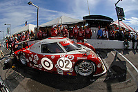 (L to R): Eventual winner #02 Lexus/Riley of Dan Wheldon, Scott Dixon and Casey Mears exits their pit following the final pit stop.
