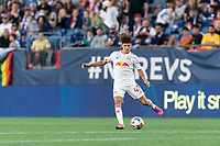 FOXBOROUGH, MA - JUNE 23: John Tolkin #47 of New York Red Bulls passes the ball during a game between New York Red Bulls and New England Revolution at Gillette Stadium on June 23, 2021 in Foxborough, Massachusetts.