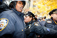 "After a slight altercation with a protester the NYPD responds with a heavy hand in Zuccotti Park on November 17, 2011 in New York City.  After subduing the perpetrator, who wound up bleeding profusely from his head, the police were jeered by hundreds of protesters with the chant, ""Get out of our park!"""