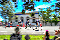 The peloton passes through Martinborough Square during stage three of the NZ Cycle Classic UCI Oceania Tour in Wairarapa, New Zealand on Tuesday, 24 January 2017. Photo: Dave Lintott / lintottphoto.co.nz