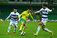 29th December 2020; Carrow Road, Norwich, Norfolk, England, English Football League Championship Football, Norwich versus Queens Park Rangers; Emi Buendia of Norwich City takes on Niko Hämäläinen of Queens Park Rangers