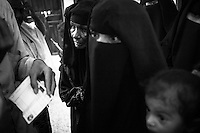"""Mothers with their children wait for attendance at a rural hospital which assists malnourished children in the impoverished district of Bayt al-Faqih, Yemen.<br /> <br /> Dr Yahya Hassan, who operates the outpatient clinic, says """"some of the malnutrition cases he has seen in recent weeks are the worst I have seen in the past 2 years of working at the centre"""".<br /> <br /> 267.000 children in Yemen are at risk of death from malnutrition already.<br /> <br /> October 10th 2012."""