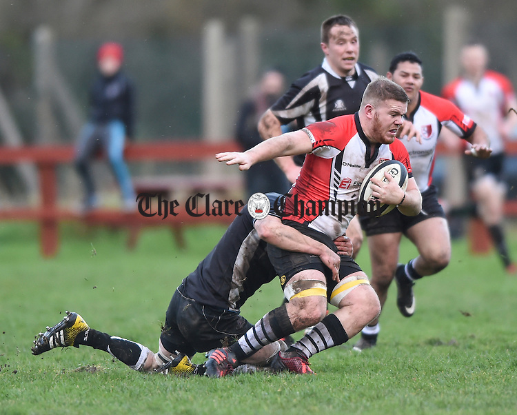 Aidan Mc Mahon of St Senan's in action against Oisin Walsh of Galbally during their Challenge cup semi-final at Slattery park, Shannon. Photograph by John Kelly.