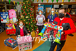 The Tralee branch of St Vincent de Paul receive Christmas toys from the staff of UHK on Monday night. Front: Paddy Kevane (President Kerry Branch of SvP), Kneeling Kit Ryan (SvP), Carol Spellman and Siobhan McCarthy from UHK