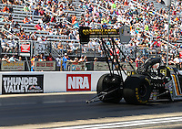 Jun 19, 2016; Bristol, TN, USA; An NRA logo is visible on the wall as NHRA top fuel driver Tony Schumacher races during the Thunder Valley Nationals at Bristol Dragway. Mandatory Credit: Mark J. Rebilas-USA TODAY Sports