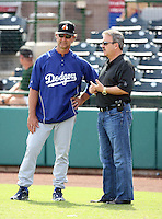 Don Mattingly (L), Ned Colletti (R) - Phoenix Desert Dogs - 2010 Arizona Fall League. Mattingly, the Dodgers new manager, meets with Dodgers general manager Ned Colletti before an Arizona Fall League game at Scottsdale Stadium - 10/23/2010.Photo by:  Bill Mitchell/Four Seam Images..