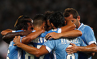 Calcio, Serie A: Lazio vs Udinese. Roma, stadio Olimpico, 25 agosto 2013.<br /> Lazio midfielder Antonio Candreva, second from left, back to camera, celebrates with teammates after scoring on a penalty kick during the Italian Serie A football match between Lazio and Udinese at Rome's Olympic stadium, 25 August 2013.<br /> UPDATE IMAGES PRESS/Riccardo De Luca