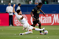 CARSON, CA - MAY 8: Derrick Williams #3 of the Los Angeles Galaxy tackles Jose Cifuentes #11 of LAFC during a game between Los Angeles FC and Los Angeles Galaxy at Dignity Health Sports Park on May 8, 2021 in Carson, California.