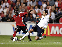 US midfielder Clint Dempsey (8) slide tackles the ball away from Trinidad & Tobago defender Osei Telesford (4).  The U.S. Men's National Team defeated Trinidad & Tobago 3-0 at Toyota Park in Bridgeview, IL on September 10, 2008.