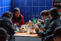 Peru, Cusco, San Pedro Market.  Customers Eating in the Food Court Area of the Market.