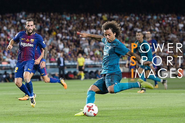 Marcelo da Silva of Real Madrid (R) attempts a kick during the Supercopa de Espana Final 1st Leg match between FC Barcelona and Real Madrid at Camp Nou on August 13, 2017 in Barcelona, Spain. Photo by Marcio Rodrigo Machado / Power Sport Images