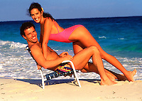 Young couple cuddling on the beach