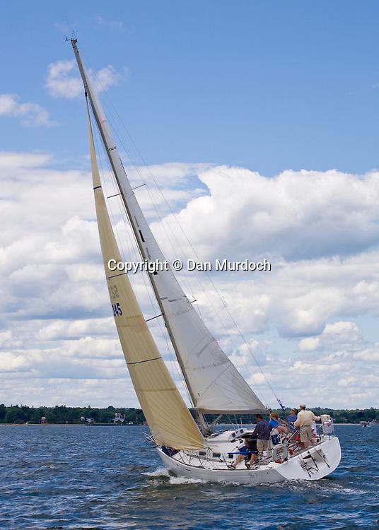 Sloop sailing upwind under blue skies