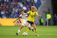 LE HAVRE, FRANCE - JUNE 20: Tobin Heath #17, Olivia Schough #22 during a 2019 FIFA Women's World Cup France group F match between the United States and Sweden at Stade Océane on June 20, 2019 in Le Havre, France.