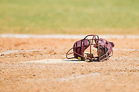 A catcher's mask sits on home plate during the game between the College of Charleston Cougars and the Davidson Wildcats at Wilson Field on March 12, 2011 in Davidson, North Carolina.  The Wildcats defeated the Cougars 8-3.  Photo by Brian Westerholt / Four Seam Images