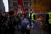 """New York, New York<br /> November 15, 2011<br /> <br /> After the police clear Zuccotti Park many of the evicted """"Occupy Wall Street"""" protesters, reconvened in Foley Square but some of them stayed around the park with their belongings not knowing where to go."""