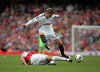 Pictured: Mark Gower of Swansea (TOP) is tackled by Francis Coquelin of Arsenal. Saturday 10 September 2011<br /> Re: Premiership Arsenal v Swansea City FC at the Emirates Stadium, London.
