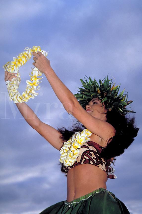 Hawaiian Hula Dancer at Sunrise. leaf hair wreath, lei, portrait, smiling, profile, woman, women, female. Katie Lopes. Hawaii.