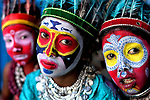 Performers with colourful face paints preparing to get back to work by Avishek Das